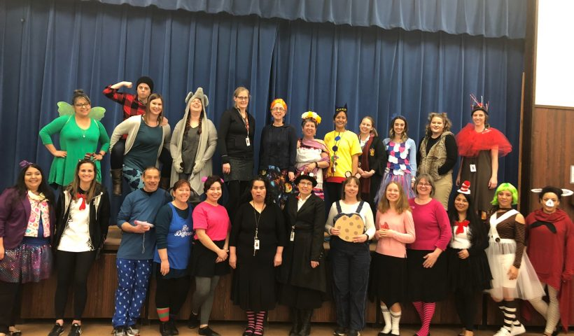 Adults dressed up for Dr. Seuss week.